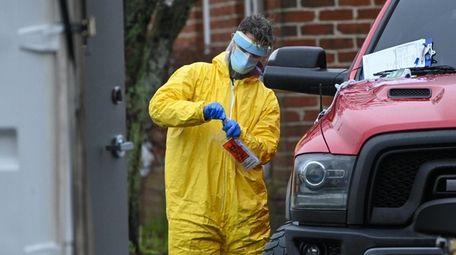 ProHealth workers conduct coronavirus tests in Riverhead Sunday.
