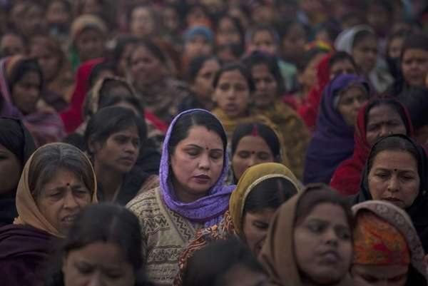 Indian women offer prayers for a gang rape