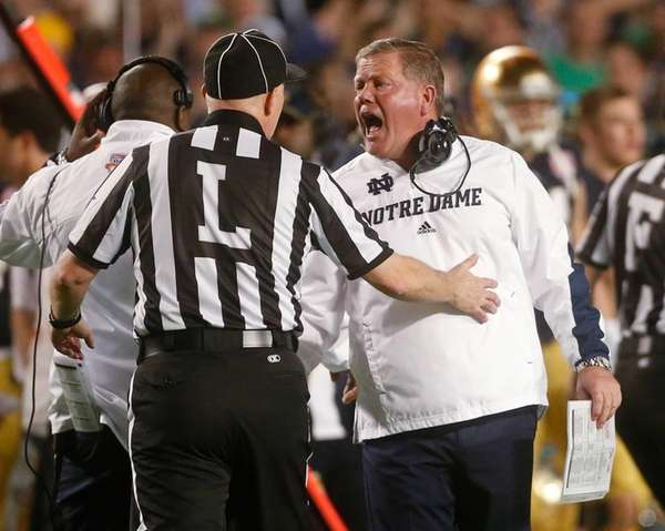 Notre Dame head coach Brian Kelly argues a