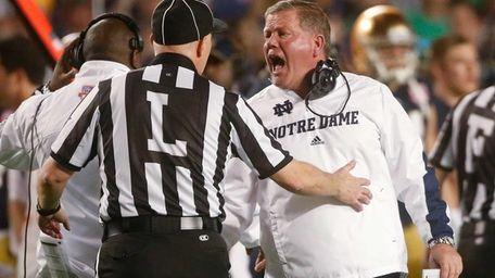 Notre Dame head coach Brian Kelly argues a