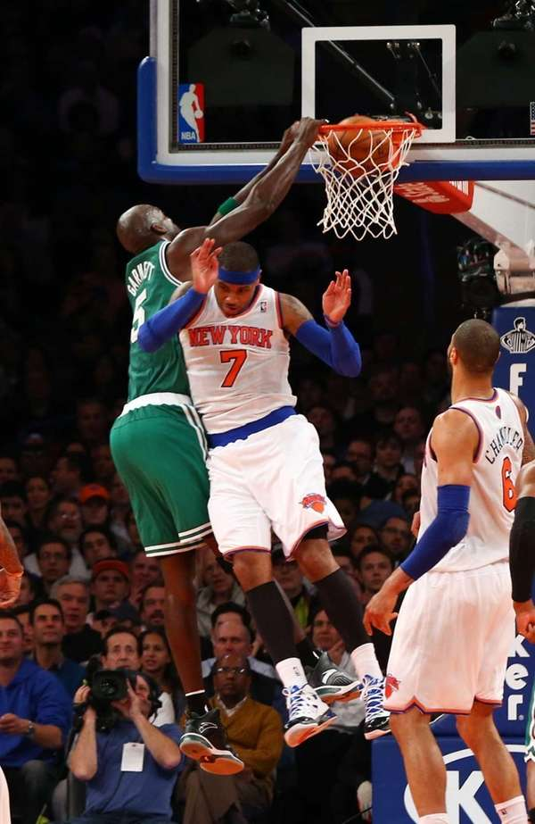 Kevin Garnett of the Boston Celtics dunks over