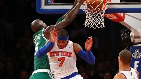 Kevin Garnett of the Boston Celtics dunks over