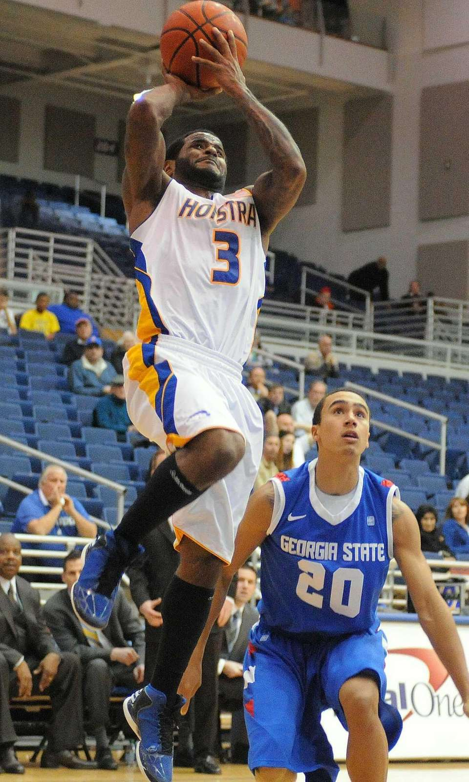 Hofstra's Stevie Mejia drives inside the paint and