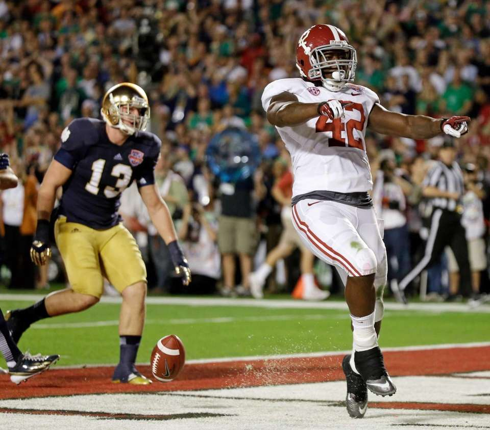 Alabama's Eddie Lacy (42) reacts after rushing for