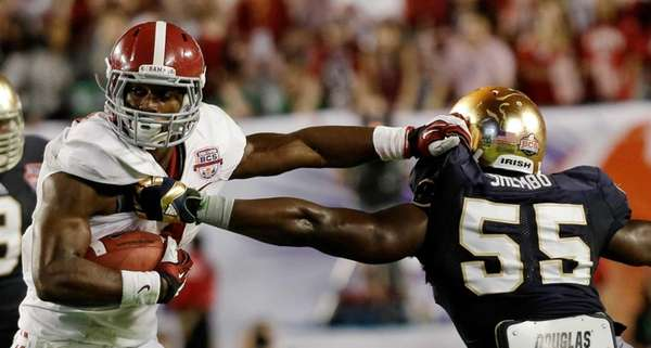 Alabama's T.J. Yeldon tries to get past Notre