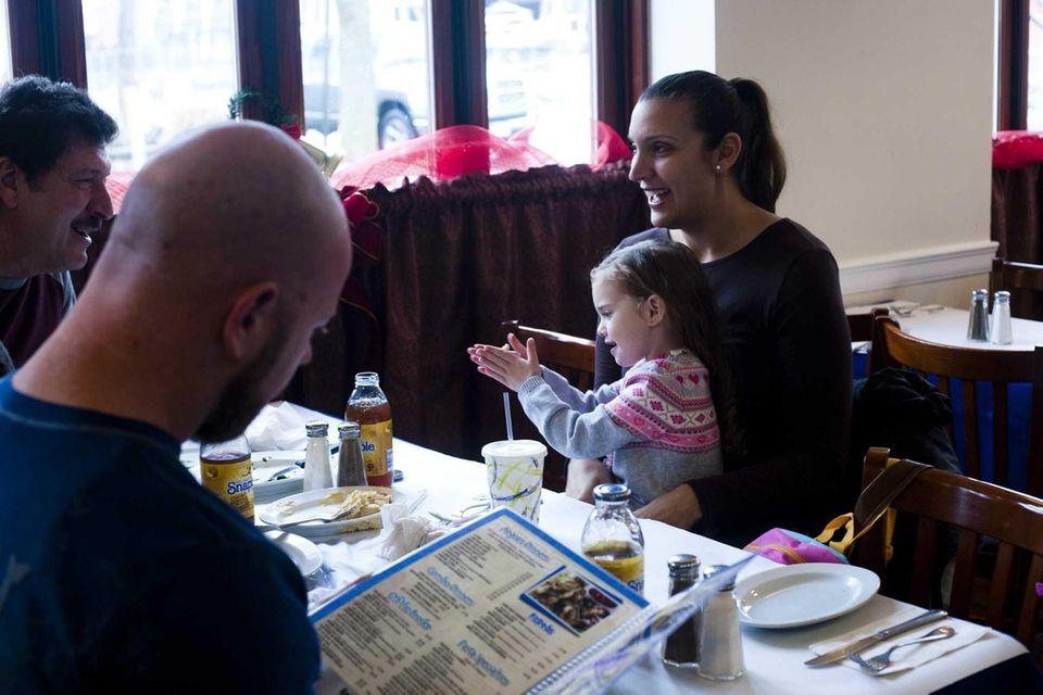 Johanna Riddick of Centereach holds daughter Tessa, age