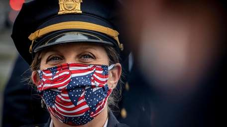A Suffolk County police officer wears a mask.