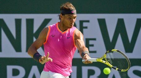 Rafael Nadal hits a forehand to Karen Khachanov