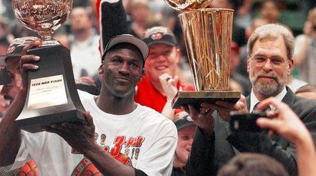 Chicago Bulls' Michael Jordan, left, holds the Most