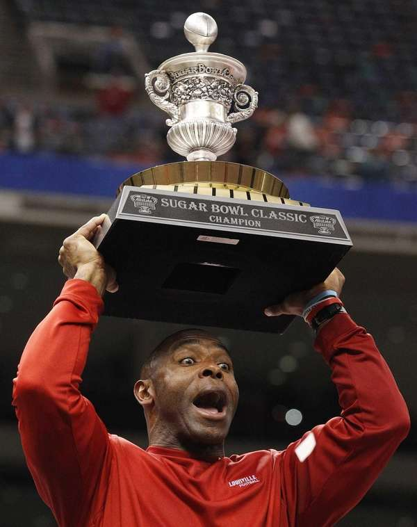 Louisville head coach Charlie Strong celebrates following a