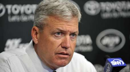 Rex Ryan listens to a question at the