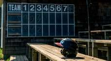 A helmet sits alone in the bleachers of