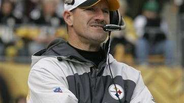 Pittsburgh Steelers coach Bill Cowher looks on during