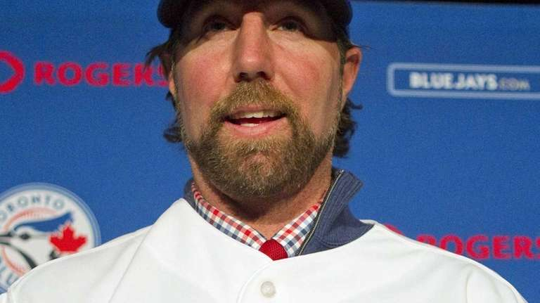 New Toronto Blue Jays pitcher R.A. Dickey poses