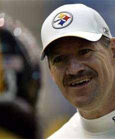 Bill Cowher, right, talks with safety Troy Polamalu