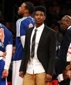 Injured Iman Shumpert of the Knicks looks on