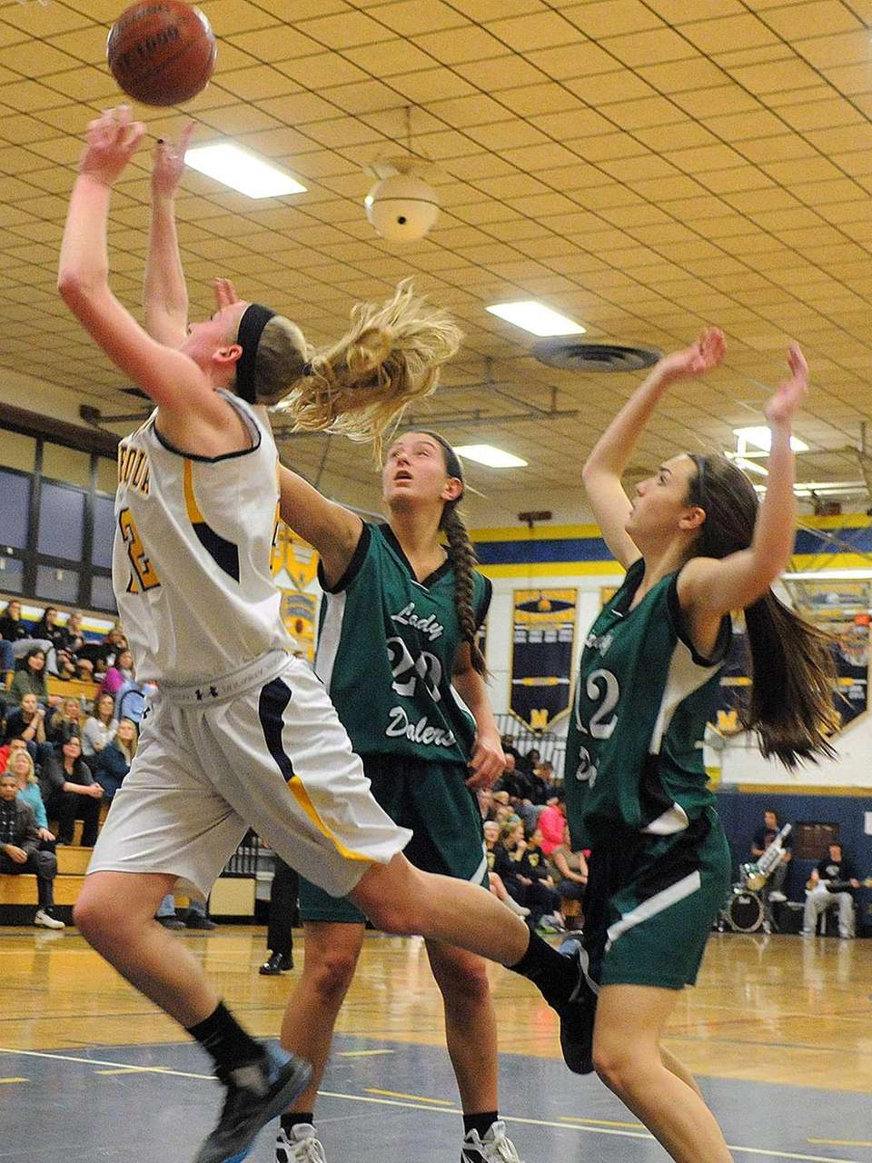 Massapequa's Lauren VanBuren, left, looks to drive past
