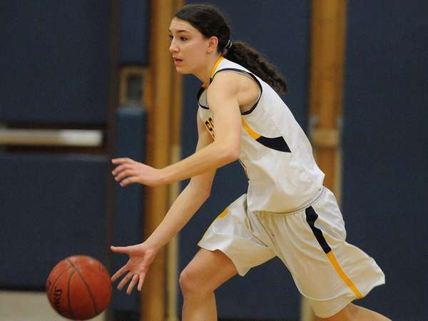 Massapequa's Morgan Roessler dribbles upcourt in the first