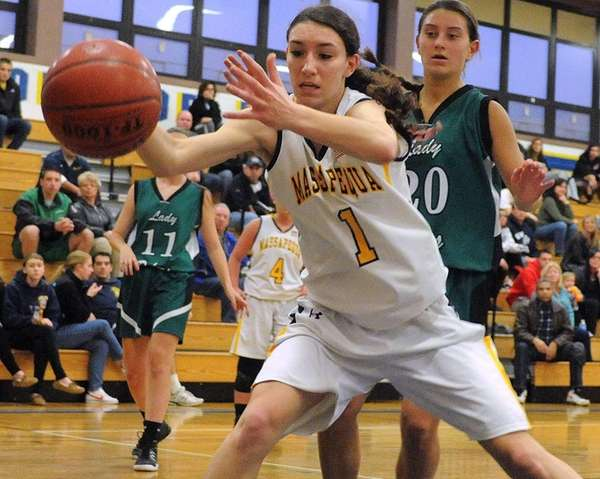 Massapequa's Morgan Roessler tries to keep a ball