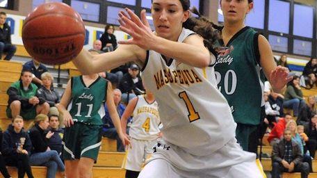 Massapequa's Morgan Roessler tries to keep a ball