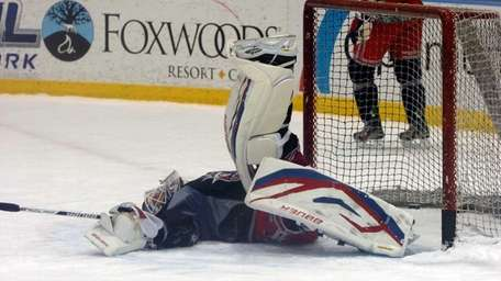 Henrik Lundqvist makes a save during practice at