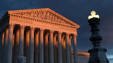 The Supreme Court is seen at sunset in