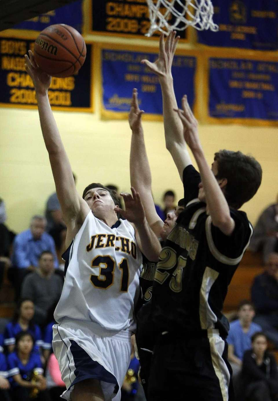 Jericho's Erik Kanzer goes for the layup against