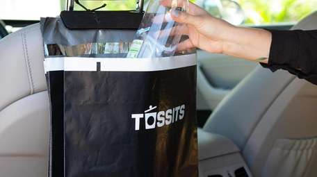 Tossits car garbage bags, which hang behind the