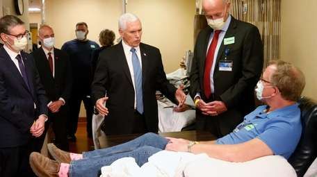Vice President Mike Pence speaks with Dennis Nelson,