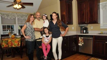 Karin and Wayne Goodman with their daughters, clockwise