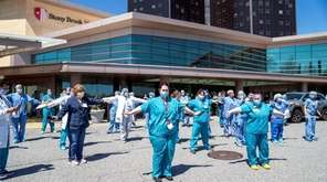 Nurses and doctors wait for the Blue Angels