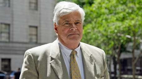 Dean Skelos leaves federal court in Manhattan during