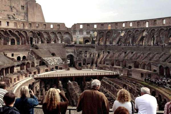 Tourists visit the Colosseum in Rome.