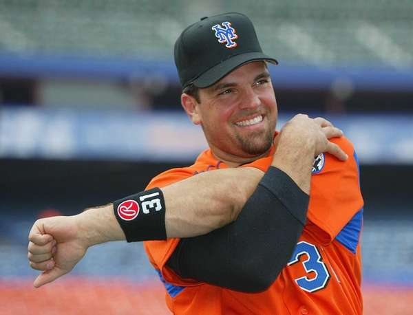 Mike Piazza smiles as he stretches with the