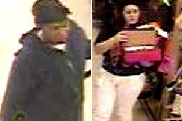 Police have released surveillance photos of two suspects