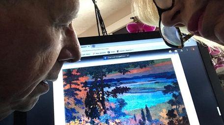 Sandra Gallof and her husband, Irwin, discuss paintings