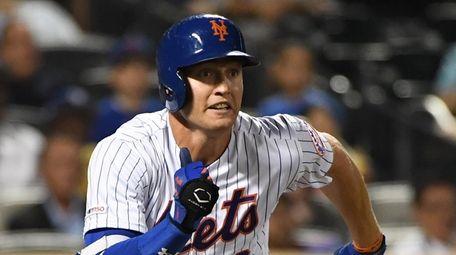 Mets' Brandon Nimmo runs along the first base