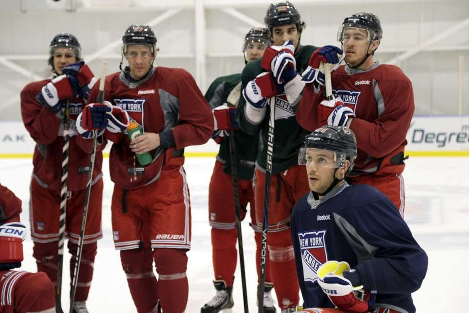 New York Rangers players, including Ryan Callahan, bottom
