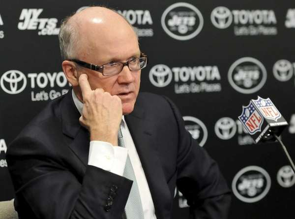 Woody Johnson talks to the media during a