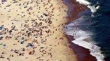 Beachgoers enjoy the final days of summer at