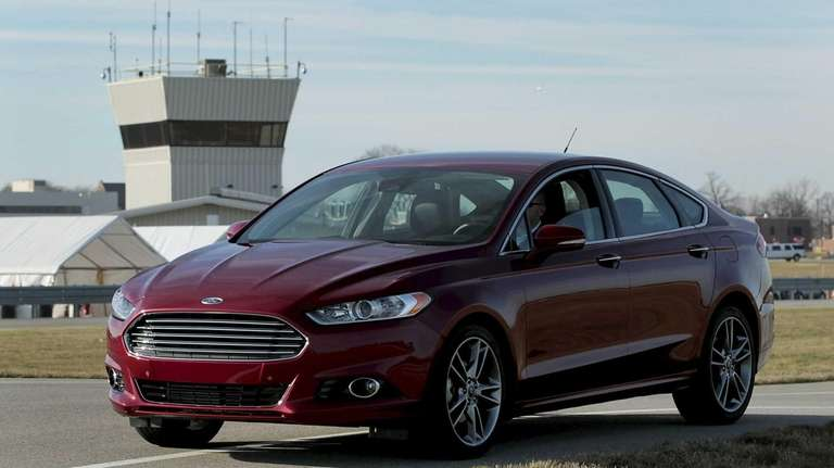 The 2013 Ford Fusion vehicle sits parked on
