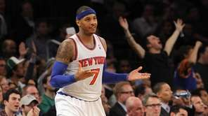 Carmelo Anthony reacts after a 3-point shot during