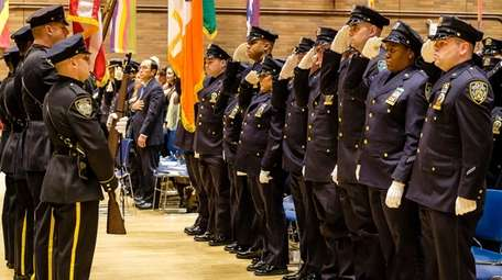 Officers being promoted to detective salute during an