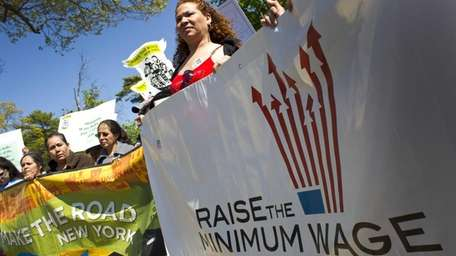 Workers demonstrate in Brentwood, urging an increase in