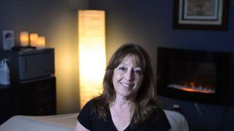 Marie Freiss is a licensed massage therapist. She