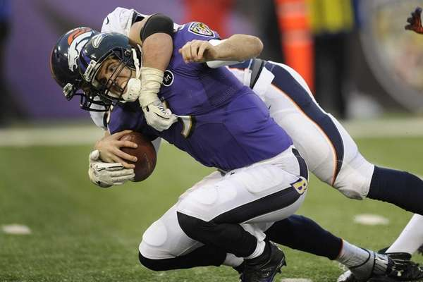 Baltimore Ravens quarterback Joe Flacco gets sacked by
