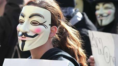 Activists from the online group KnightSec and Anonymous