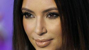 Kim Kardashian poses for photographers on the red