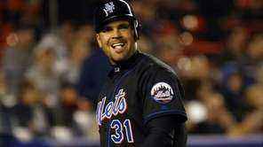 Mets catcher Mike Piazza reacts after striking out