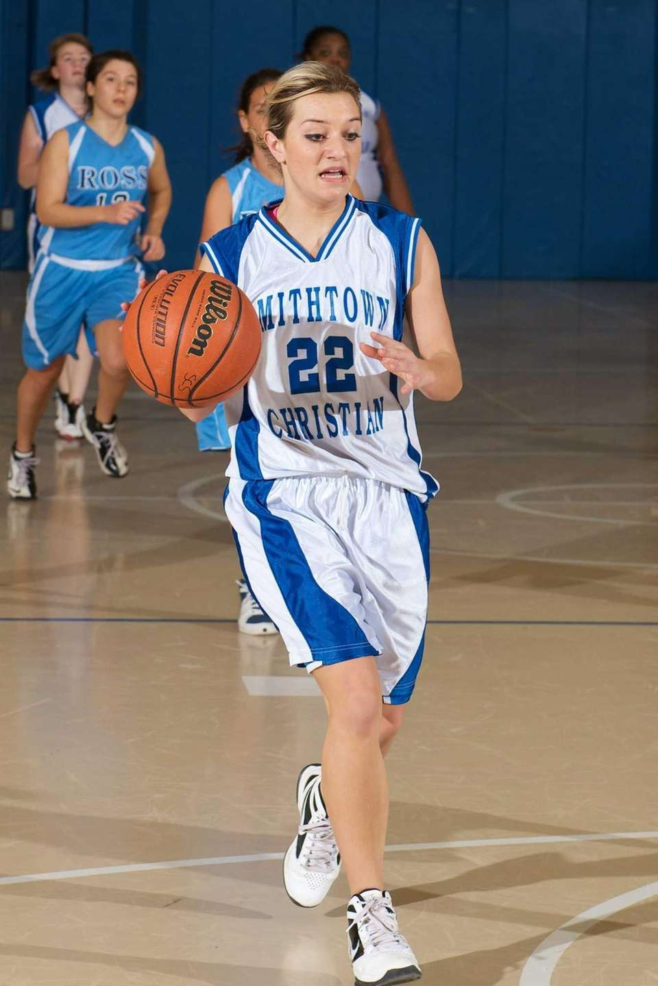 Smithtown Christian guard Victoria Linsalato (22) drives to